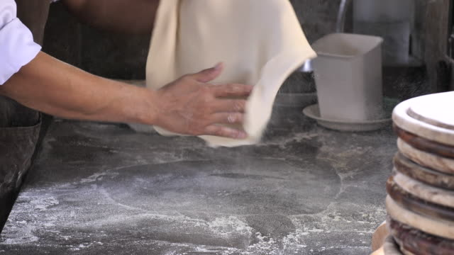 chef tossing pizza dough, skillful of chef preparing for cooking a pizza - italian food stock videos and b-roll footage
