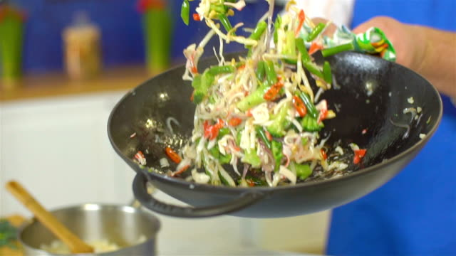 chef tossing vegetables in wok, slo mo - mixing stock videos and b-roll footage