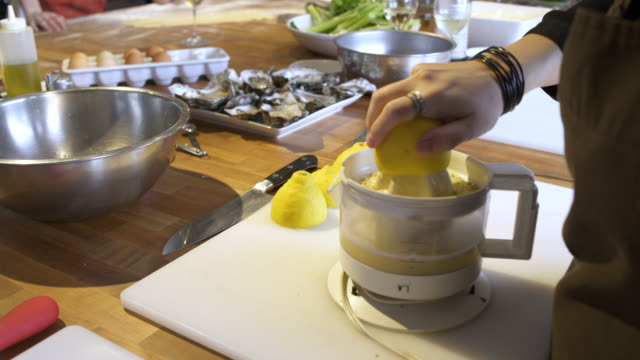 chef using a lemon squeezer machine - whidbey island stock videos and b-roll footage
