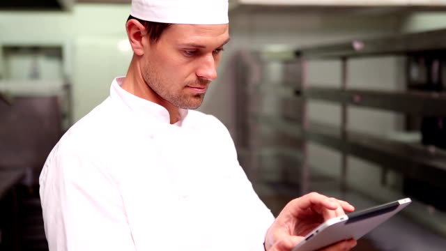 Chef using a tablet computer