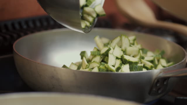 chef using frying pan - courgette stock videos and b-roll footage
