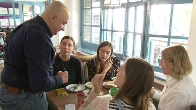 chef who lost three restaurants in syrian civil war opens new restaurant in london; england: london: soho: int imad alarnab welcoming customer... - customer stock videos & royalty-free footage