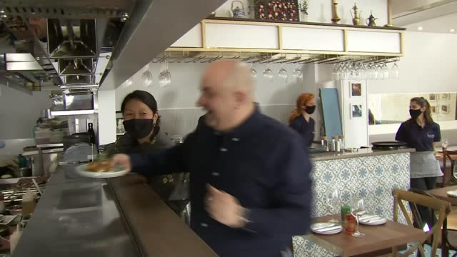 chef who lost three restaurants in syrian civil war opens new restaurant in london; england: london: soho: ext gv imad's syrian kitchen imad alarnab... - war and conflict stock videos & royalty-free footage