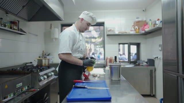 chef working at commercial kitchen - chef's hat stock videos & royalty-free footage