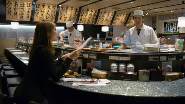 ws a chef works in a sushi restaurant / tokyo, japan - japanese food stock videos and b-roll footage