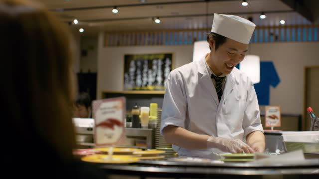 ms a chef works in a sushi restaurant / tokyo, japan - sushi video stock e b–roll