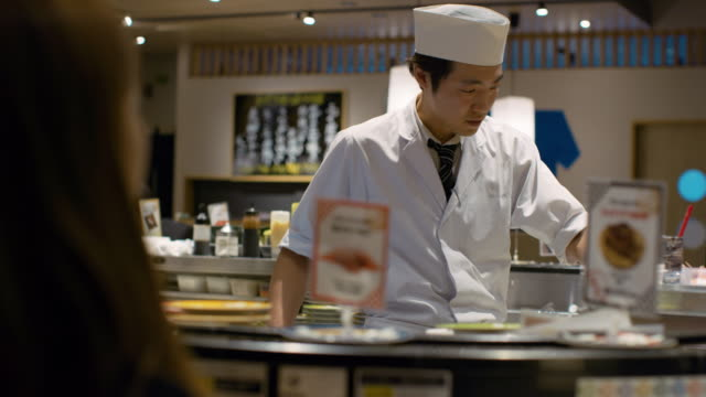 MS A chef works in a sushi restaurant / Tokyo, Japan