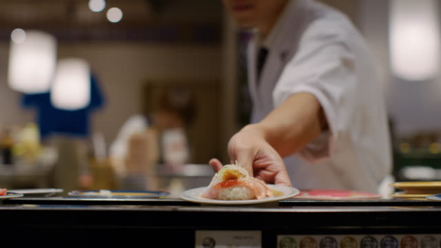 cu a chef works in a sushi restaurant / tokyo, japan - sushi video stock e b–roll