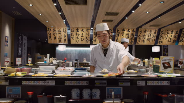 ws a chef works in a sushi restaurant / tokyo, japan - one mid adult man only stock videos & royalty-free footage