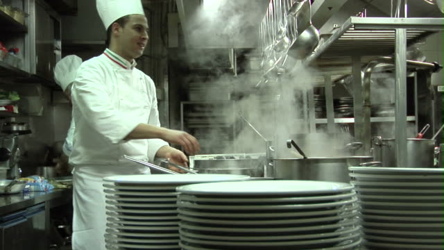 t/l, cu, zi, chefs cooking in restaurant kitchen - stack of plates stock videos & royalty-free footage