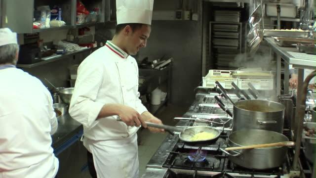 SLO MO, MS, Chefs cooking in restaurant kitchen