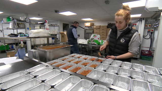chefs from london catering companies now preparing and delivering ready meals to the vulnerable and self isolating during coronavirus crisis - meal stock videos & royalty-free footage