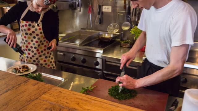 ms chefs preparing food in restaurant kitchen - two people stock videos & royalty-free footage