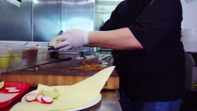 Chefs Working in Mexican Restaurant Kitchen