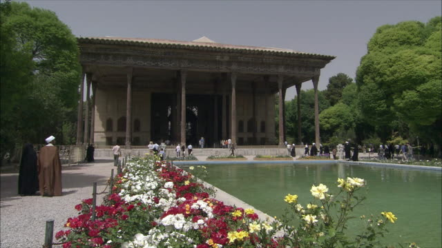 WS Chehel Sotoun pavilion with pool and flowers in foreground, Isfahan, Iran