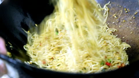 cheif cooking chinese rice noodle in the kitchen - noodles stock videos & royalty-free footage