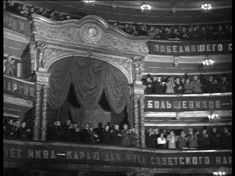 cheka's 20th anniversary in bolshoi theatre audience applauding zhdanov yezhov molotov khrushchev in presidium / moscow russia - 20th anniversary stock videos & royalty-free footage
