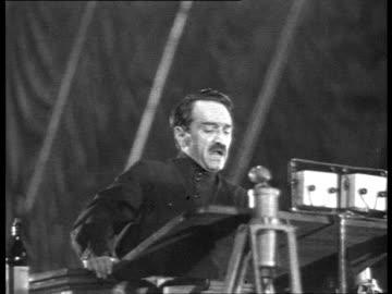 cheka's 20th anniversary in bolshoi theatre, mikoyan speech, audience applauding / moscow, russia/ audio - 1937 bildbanksvideor och videomaterial från bakom kulisserna