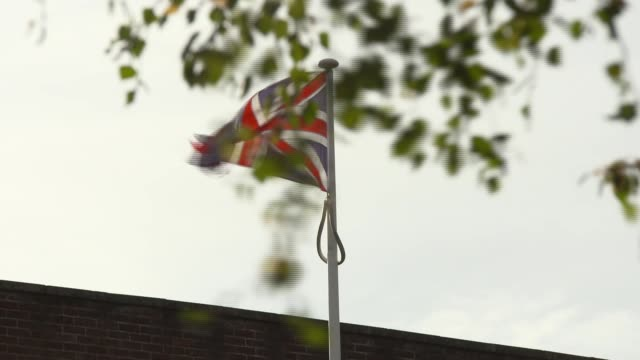 essex chelmsford ext chelmsford prison building / sign hmp yoi chelmsford / union jack on flagpole / spiderweb on pole / decorator van arriving / - pole stock videos & royalty-free footage