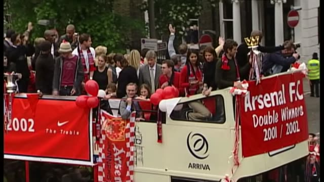 Chelsea aim for record number of consecutive wins T12050223 1252002 Arsenal FC players along on open topped bus with Premiership trophy past cheering...