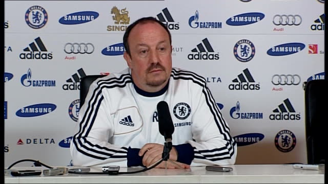 benitez appeals for fans to get behind the team surrey cobham int benitez press conference sot london stamford bridge ext sign promoting match... - スタンフォードブリッジ点の映像素材/bロール
