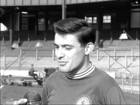 chelsea fc captain bobby tambling interviewed england london chelsea football grounds ext chelsea fc players training on pitch pan bobby tambling... - tottenham hotspur f.c stock videos & royalty-free footage