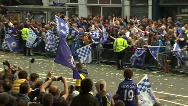 Chelsea FC celebrate Premier League title win ENGLAND London EXT Various shots fans with Chelsea FC flags along route behind barriers awaiting...