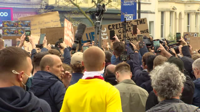 chelsea fc football fans protest outside stamford bridge against their club joining the european super league - europe stock videos & royalty-free footage