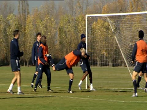 Chelsea FC players during alternative training session throwing and catching football Eidur Gudjohnsen heads ball into goal and celebrates London 07...