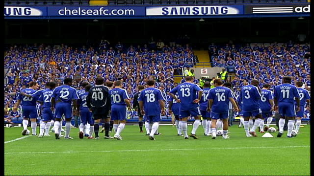 chelsea fc squad individually onto pitch / team and fan photocall general views and back views of john terry onto pitch to greet crowd as introduced... - チェルシーfc点の映像素材/bロール