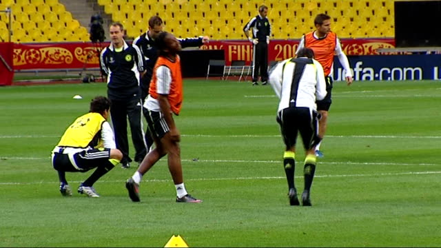 chelsea fc team training russian federation moscow luzhniki stadium ext general views chelsea team doing stretches on pitch includes avram grant along - luzhniki stadium stock videos & royalty-free footage