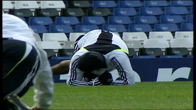 Chelsea FC training at Stamford Bridge EXT More of Drogba training doing stretching exercises / Players jogging in warmup