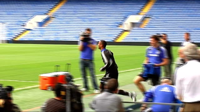 london stamford bridge ext john terry on pitch chelsea players run out on pitch individually including frank lampard ashley cole shaun wrightphillips... - chelsea f.c stock videos & royalty-free footage