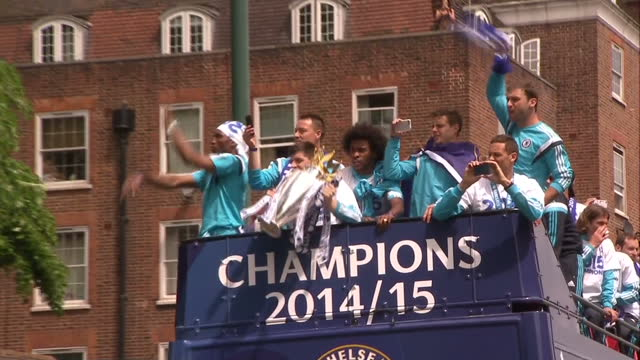 chelsea fc victory parade for premier league showing exterior shots chelsea fc players on open top bus celebrating with premier league trophy aerial... - chelsea fc bildbanksvideor och videomaterial från bakom kulisserna