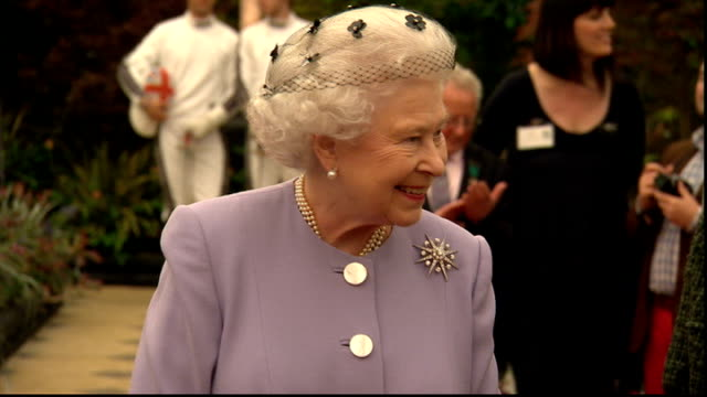 Queen has private tour prior to public opening ENGLAND London Chelsea Flower Show EXT Queen ELizabeth along through marquee Queen ELizabeth and...