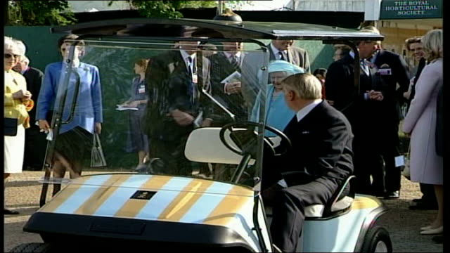 Royal Family visit POOL ENGLAND London Chelsea EXT Queen Mother out of car and along greeting / Queen Mother into golf buggy and along through to...