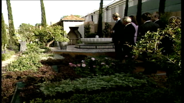 Royal Family visit POOL ENGLAND London Chelsea EXT Queen and guide along looking at various gardens / Prince Charles along / Prince Charles chatting...