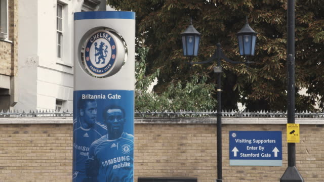 ms chelsea football club members photo on banner in front of building / fulham, london, united kingdom - rosso stock videos & royalty-free footage