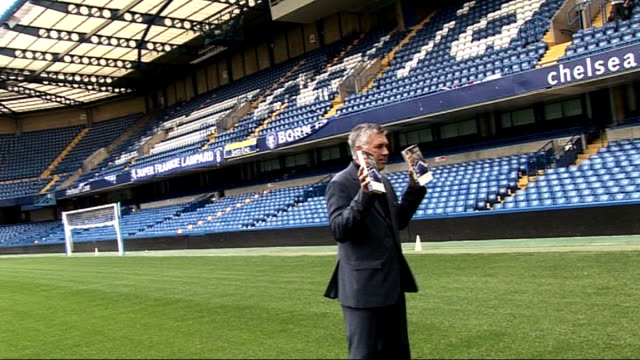 chelsea manager carlo ancelotti autobiography launch; england: london: stamford bridge: ext various of carlo ancelotti posing for photocall with... - autobiography stock videos & royalty-free footage