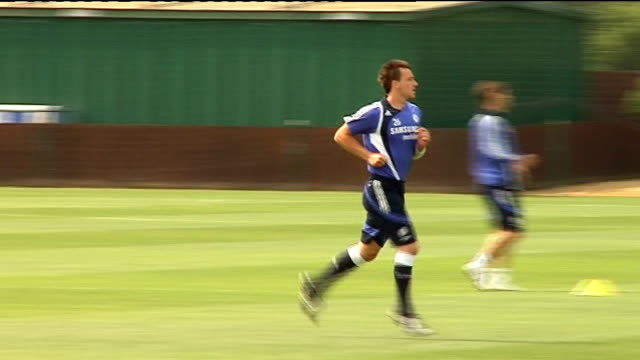 Chelsea press conference ahead of Champions League Final EXT John Terry running along during training session Didier Drogba jogging along