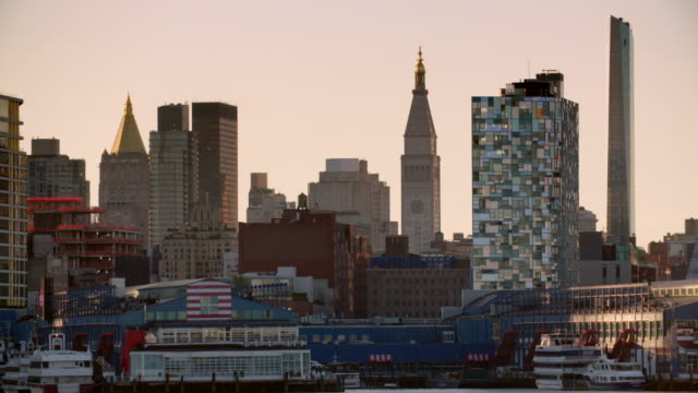 chelsea skyline along the hudson river in manhattan, new york city in the early morning hours. - chelsea new york stock videos & royalty-free footage