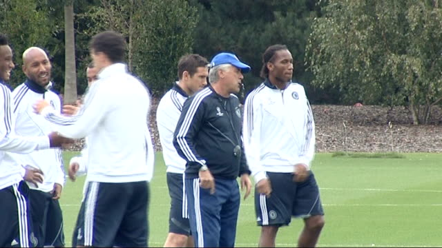 surrey cobham ext various shots of chelsea fc footballers training at training ground frank lampard standing on pitch didier drogba warming up... - cobham training ground stock videos and b-roll footage