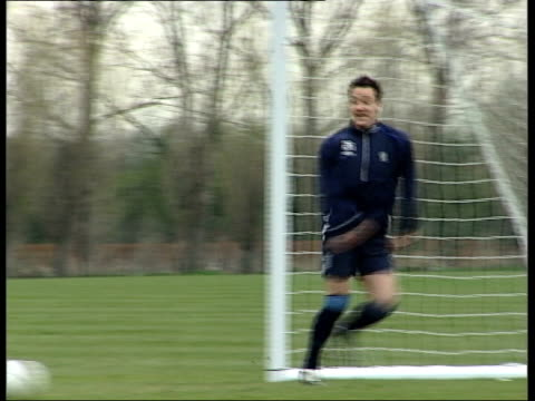 Chelsea v Arsenal in Champions League ITN Chelsea football team training John Terry training Marcel Desailly and Jimmy Floyd Hasselbaink along during...