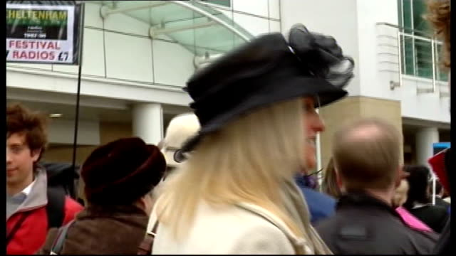 cheltenham 2009 cheltenham festival on gold cup day more racegoing ladies along in hats and in fashion - cheltenham stock videos & royalty-free footage