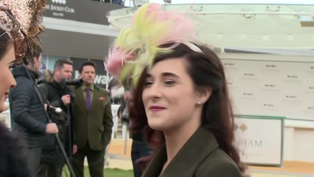 gloucestershire cheltenham racecourse ext gvs ladies and men's fashions at cheltenham ladies day / women posing in dresses and hats / dom jolly... - cheltenham racecourse stock videos and b-roll footage