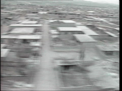 'chemical ali' receives death sentence; tx 22.3.1988 halabja: ext air view / aerial destroyed kurdish town at border with iran track forwards through... - iraq video stock e b–roll