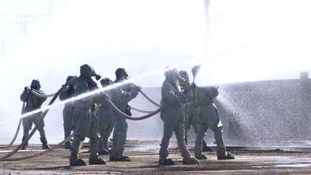 chemical crew in gas mask flowing water - emergency planning stock videos & royalty-free footage