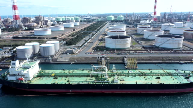 a chemical plant and huge tanker - energy efficient stock videos and b-roll footage