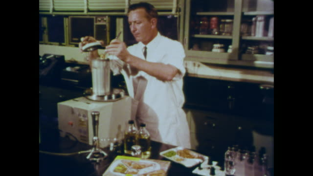 1966 chemist analyzes the food from a frozen dinner in his laboratory - radiation stock videos & royalty-free footage