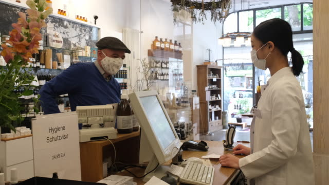chemist assisting customer at medial store - germany stock videos & royalty-free footage